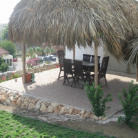 Palapa with paving stones floor at Coral Estate